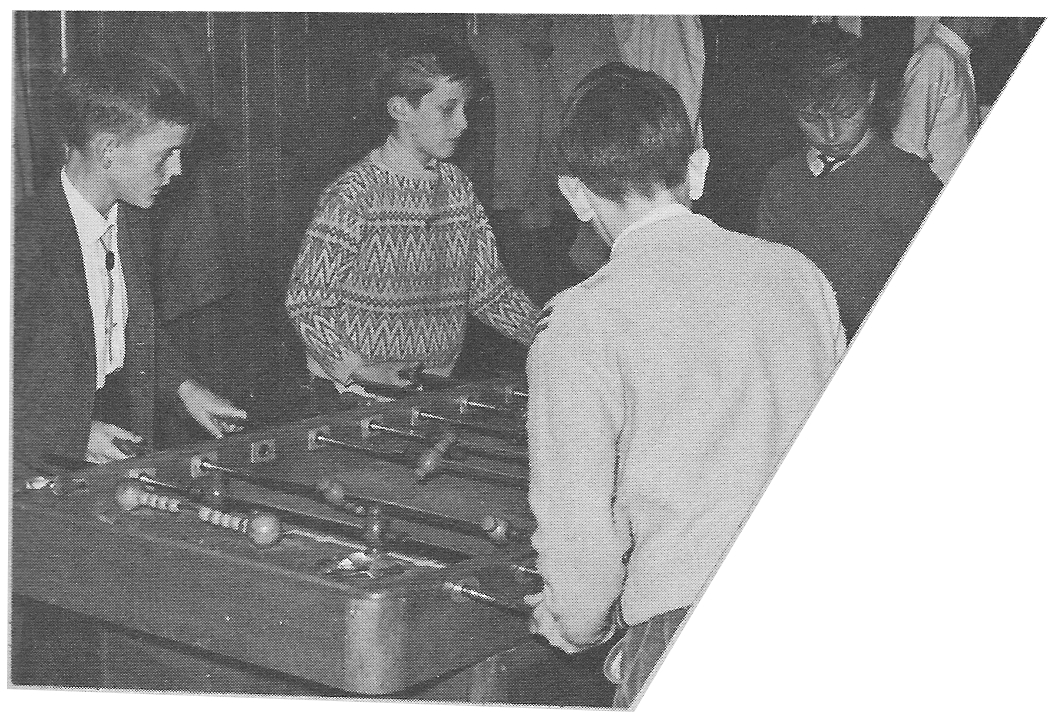 Playing Foosball Soccer Table Game in Sapiniere recreation Room  Villa Saint Jean International School  1964 Yearbook Le Chamois