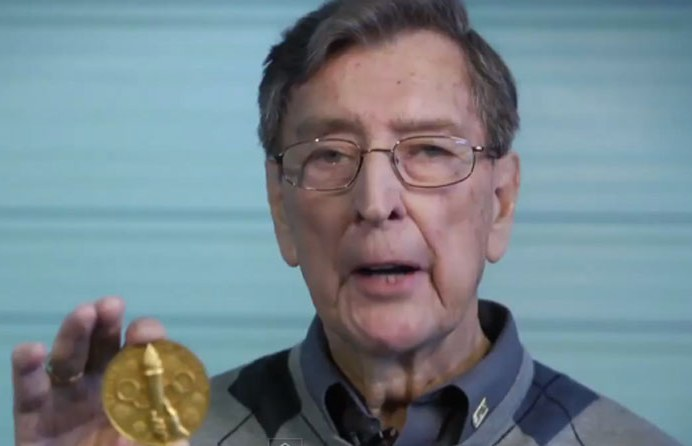 Photo: Murray Dowey Holding Olympic Gold Medal