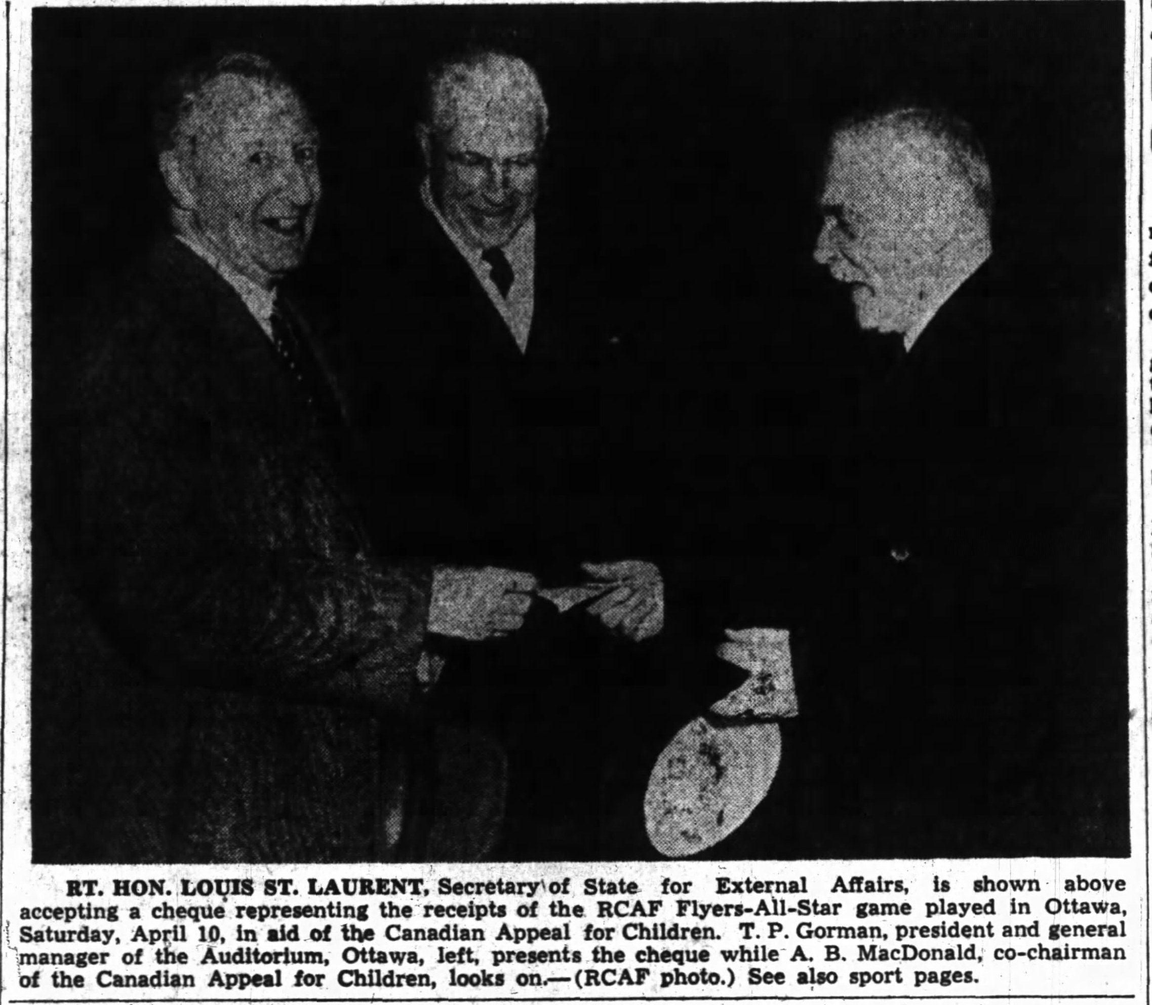 Photo: Right Honorable Louis St Laurant receives check from April 10  1948 Charity hockey  game RCAF Flyers vs NHL QSHL All Stars
