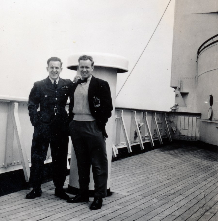 Photo: Flyers Schroeter and Boucher on the deck of the Queen Mary