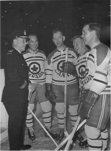 Photo: Lt–Gen. Sharp Passes on a Few Pre–Game Tips to 4 R.C.A.F. Flyers Prior to Game Against Old Pros in Ottawa
