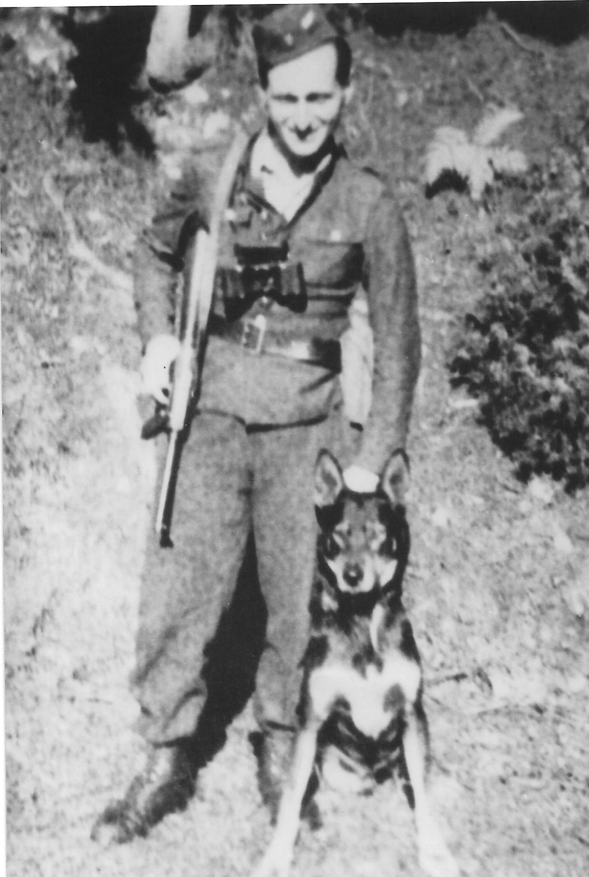 Photo: Józef Węglarz  ps Mały  with German Shepard  in 1944