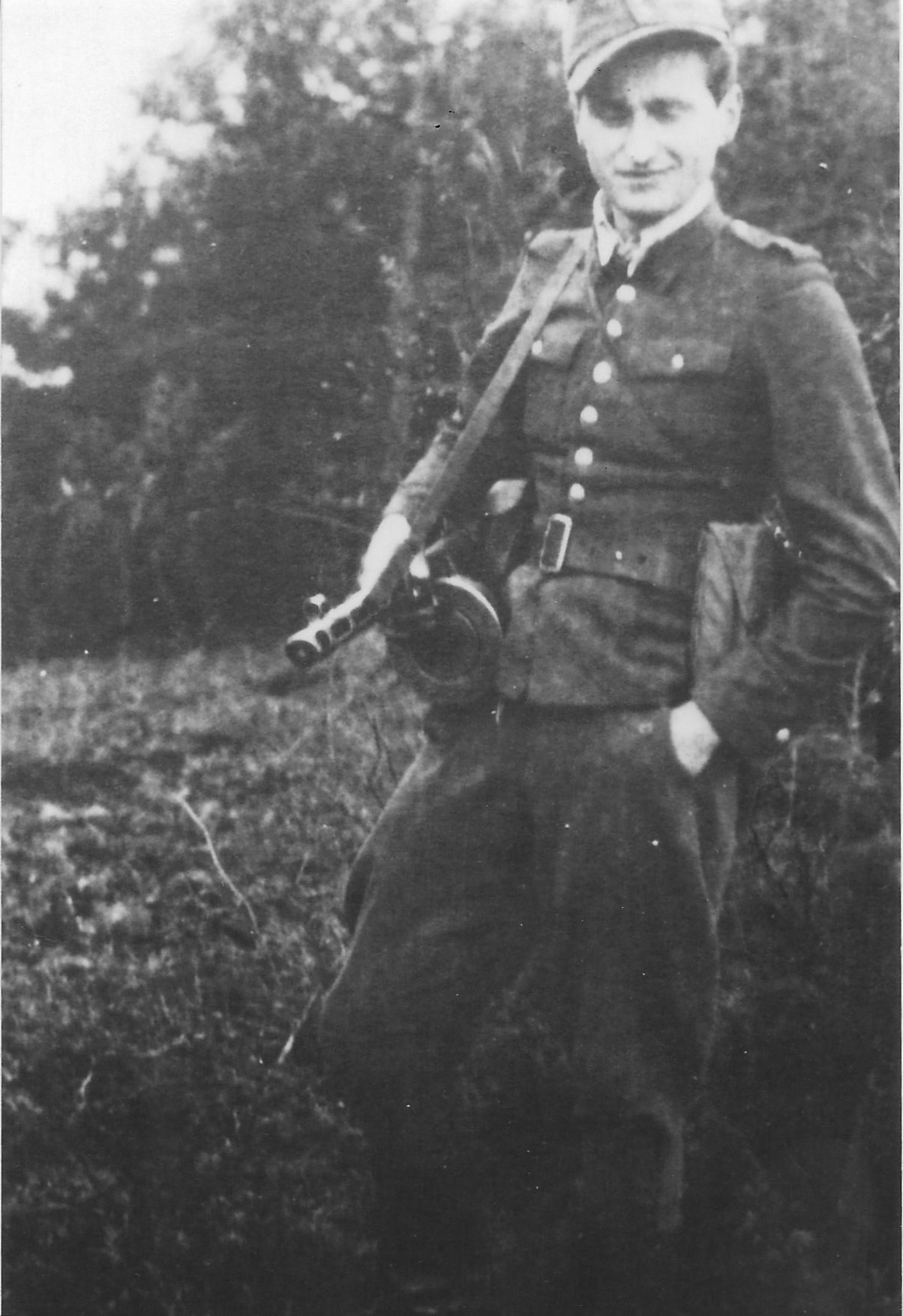 Photo:  Józef Węglarz  ps Mały  With Machine Gun in 1944