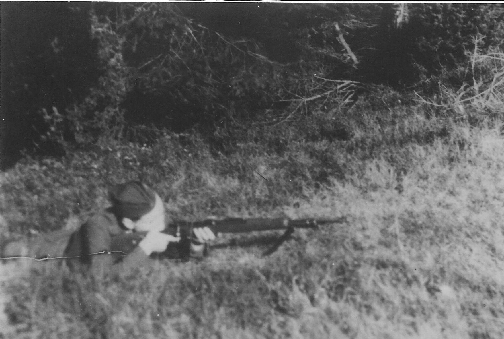 Photo:  Józef Węglarz  ps Mały  Preparing for Nazi Ambush 1944