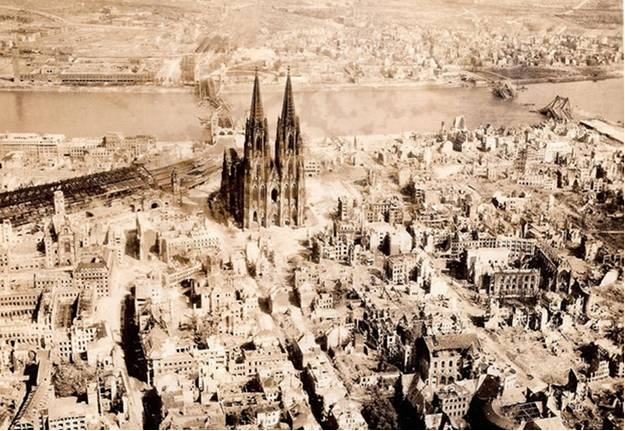 PHOTO 1: Bomb Damage around Dom Cathedral in Cologne