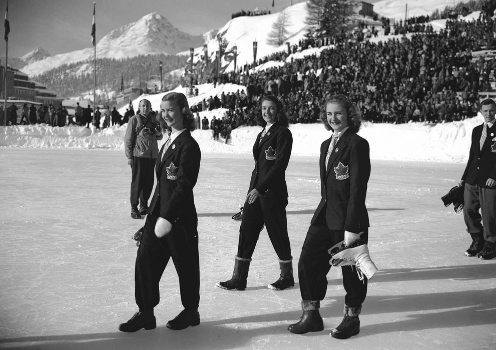 Image: Barbara Ann Scott precedes fellow Canadian skaters Marilyn Ruth Take (centre) and Suzanne Morrow, in the opening parade at the St. Moritz Olympic Games