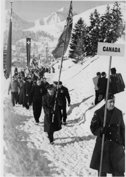 Photo: Hubert Brooks Carrying Canadian Flag at Opening Ceremonies 1948 Winter Olympics