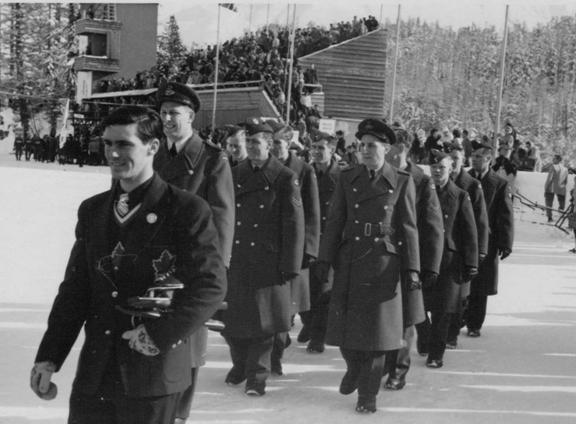 Photo: R.C.A.F. Flyers Hockey Team  March into Stad Olympique at Opening Ceremonies 1948 Winter Olympics