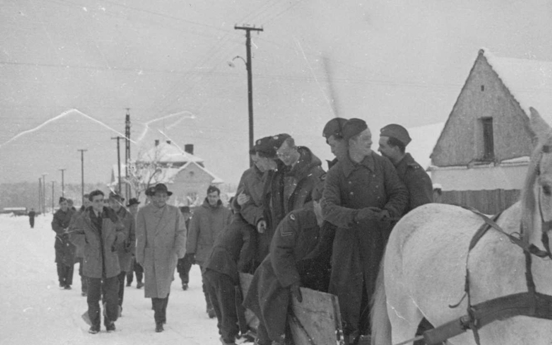Photo:Some RCAF Flyers Hitch a Horse Drawn Ride While Others Follow Behind in St Moritz