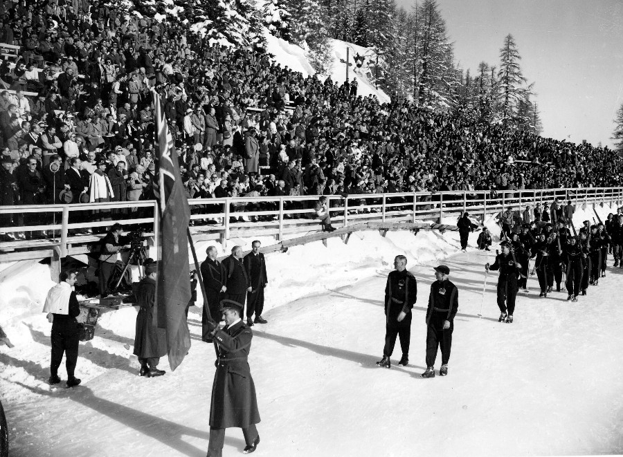 Photo: Hubert Brooks Carrying Canadian Flag Past Grandstand 1948 Winter Olympics