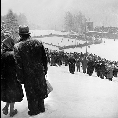 Photo:Fans Watch Canada vs Britain Ice Hockey Game from Hill 1948 Winter Olympics